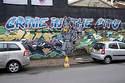 Crime in the City street art graffiti in Digbeth on 14th March 2020 in Birmingham, United Kingdom. Digbeth is an area of Central Birmingham, England. Following the destruction of the Inner Ring Road, Digbeth is now considered a district within Birmingham City Centre. As part of the Big City Plan, Digbeth is undergoing a large redevelopment scheme that will regenerate the old industrial buildings into apartments, retail premises, offices and arts facilities. There is still however much industrial activity in the south of the area.