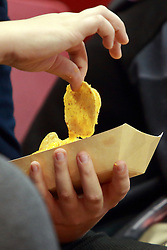 05 November 2016:  child eating nachos during an NCAA  mens basketball game where the Quincy Hawks lost to the Illinois State Redbirds in an exhibition game at Redbird Arena, Normal IL