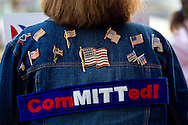 A Mitt Romney supporter stands outside a caucus location before Republican presidential candidate and former U.S. Sen. Rick Santorum speaks during a campaign stop at Westminster Christian Academy in Town and Country, Missouri.