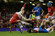 James Davies of Wales takes a tumble over an Italian player. Wales v Italy , NatWest 6 nations 2018 championship match at the Principality Stadium in Cardiff , South Wales on Sunday 11th March 2018. pic by Andrew Orchard, Andrew Orchard sports photography