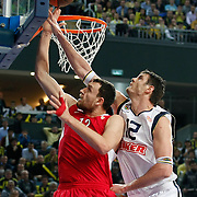 Fenerbahce Ulker's Darjus LAVRINOVIC (R) and Olympiacos's Loukas MAVROKEFALIDES (L) during their Euroleague Basketball Top 16 Game 5 match Fenerbahce Ulker between Olympiacos at Sinan Erdem Arena in Istanbul, Turkey, Thursday, February 24, 2011. Photo by TURKPIX