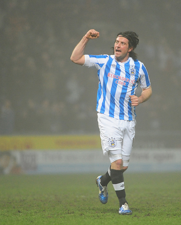 Huddersfield Town's Alan Lee celebrates the win at the end of the game..Football - npower Football League Championship - Huddersfield Town v Middlesbrough - Tuesday 05th March 2013 - John Smith's Stadium - Huddersfield..© CameraSport - 43 Linden Ave. Countesthorpe. Leicester. England. LE8 5PG - Tel: +44 (0) 116 277 4147 - admin@camerasport.com - www.camerasport.com