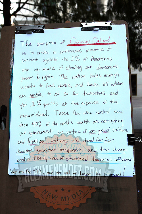 A sign stating the purpose of Occupy Orlando sits on a stand in front of the Orange County History Center on Wednesday, October 5, 2011 in Orlando, Florida. (AP Photo/Alex Menendez)