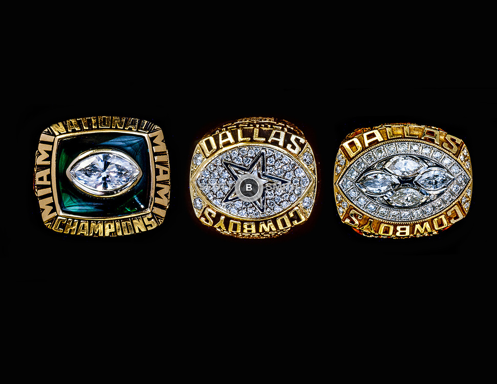 Close up view of former University of Miami Hurricane coach and NFL Hall of Fame coach Jimmy Johnson's three championship rings. Rings were photographed for promotional use in the marketing of Coach Johnson's Three Rings Bar and Grill in the Eden Roc Resort, Miami Beach, 1995.