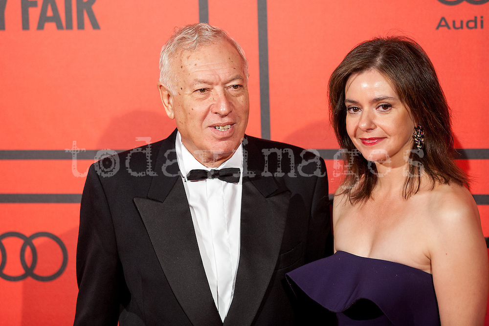 José Manuel García-Margallo and Lourdes Garzón during the photocall of Vanity Fair 5th Anniversary party In Madrid