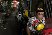 A small stage is erected in a narrow alleyway off Yaowarat Road in Bangkok's Chinatown for a cosy Xiqu performance in the local neighbourhood.