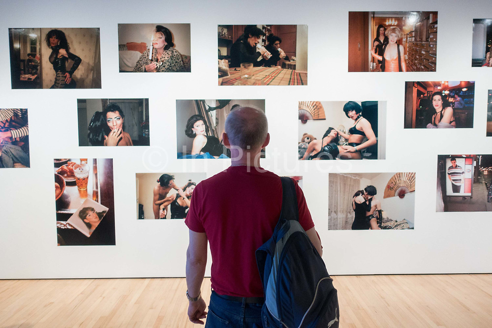 A man looking at photography by French artist, Kader Attia at the Hayward Gallery on the 19th April 2019 in London in the United Kingdom. In this series, Attia has taken a series of intimate photographic portraits of a group of Algerian transgender sex workers living and working in Paris. The work forms part of Attias The Museum of Emotion exhibition, a series of work from the past two decades.