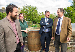 Pictured: Josiah Lockhart, Maia Gordon, Keith Brown and George Elliis<br /> <br /> Cabinet Secretary for Economy, Jobs & Fair Work Keith Brown visited Gorgie City Farm today  to mark their accreditation as the 800th Living Wage employer in Scotland. Mr Brown met Josiah Lockhart, CEO and undertook a short tour of the farm, celebrating their accreditation and promoting the Living Wage more generally. The Scottish Government has set a target of reaching 1,000 Scottish-based Living Wage Accredited Employers by autumn 2017. While at the farm Mr Brown met Maia Gordon, Kirsty McGoff (17) and Zoe White (18), who have benefited from the living wage, and George Ellis, chair of the farm's board of directors<br /> Ger Harley   EEm 18 May 2017