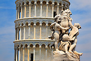 The Leaning Tower in Pisa with the top of a nearby fountain in the foreground