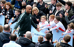 Manchester City's Vincent Kompany acknowledges the fans as he arrives at the stadium before the match begins