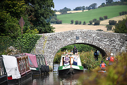 © Licensed to London News Pictures. 04/09/2021. Brecon, UK. A peaceful scene on the Monmouthshire and Brecon Canal in South Wales on a beautiful Saturday afternoon as people enjoy the late Summer weather across the UK. Photo credit: Robert Melen/LNP