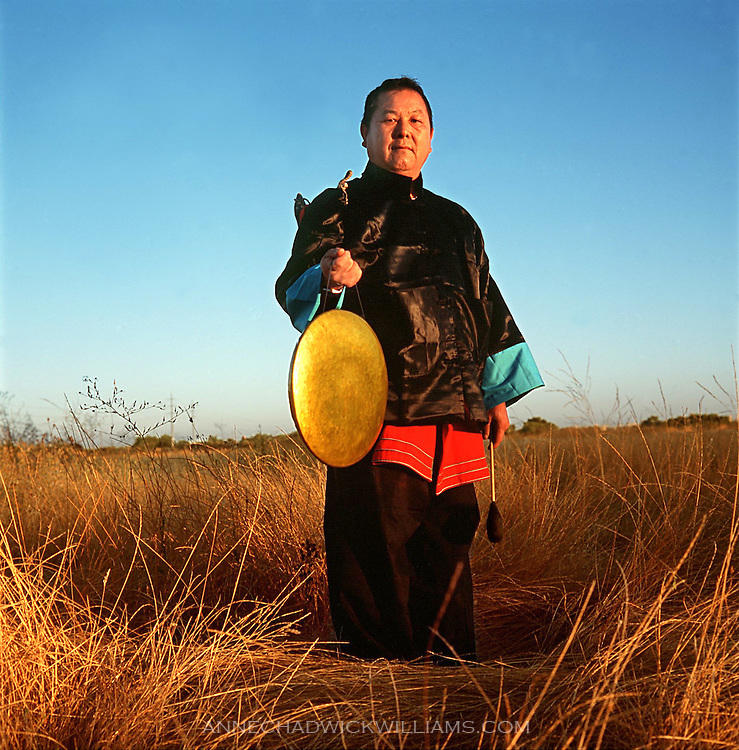 Hmong Shaman Xong Lao Vang hopes the children growing up in America with learn about their heritage and pass it along to their children. August 17, 2000.