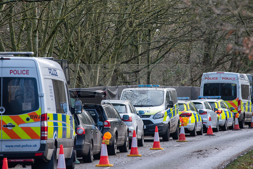 """© Licensed to London News Pictures. 11/12/2019. Gerrards Cross, UK. Police vehicles at the scene in Gerrards Cross in Buckinghamshire as the Police Service continue to search woodland. Police have been in the area conducting operations since Thursday 5th December 2019. In a press statement issued on 7th December, a Metropolitan Police spokesperson said """"Officers are currently in the Gerrards Cross area of Buckinghamshire as part of an ongoing investigation.<br /> """"We are not prepared to discuss further for operational reasons."""" Photo credit: Peter Manning/LNP"""