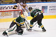 Powell River Kings goaltender Brian Wilson blocks the centring pass of Victoria Grizzlies forward Cole Pickup at the Q Centre in Colwood, British Columbia Canada on March 27, 2017.