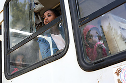 Young girls peer out the windows of a bus at the main bus station in Bahir Dar, Ethiopia on May 28, 2007.  Brokers often look for young girls traveling alone, promising them a good life with lots of money. Often they are trafficked to brothels in exchange for a mere $5. Workers from the Forum for Street Children, a local NGO, have teamed up with the local police to help curb this occurrence, educating brokers about childrens' rights and trying to intercept the girls before they meet the brokers.
