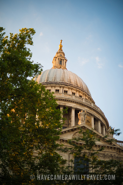 Late afternoon sun catches the dome of St Paul's Cathedral, one of the most distinctive of London's landmarks. There has been a church on this site since 604 AD. The current building, with it's massive dome, was designed by Christopher Wren and dates back to the late 17th century.