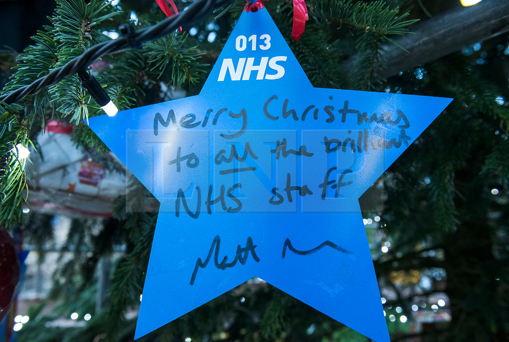 """© Licensed to London News Pictures; 17/11/2020; Bristol, UK. A star signed by the Health Secretary MATT HANCOCK is placed on a giant Christmas tree for the """"Florence NHS Christmas Tree"""" Thank You NHS Stars Fundraiser, with blue stars signed by among others the UK Prime Minister Boris Johnson, Health Secretary Matt Hancock and Deputy Chief Medical Officer Jonathan Van-Tam. For the 10th year Clifton Village in Bristol has a 50ft illuminated Christmas tree, the tallest in any UK village. Photo credit: Simon Chapman/LNP."""