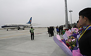HECHI, CHINA - (CHINA OUT) <br /> <br /> Airport in The Mountains  <br /> <br /> People looks at a plane after a successful route-proving flight at Hechi Jin Cheng Jiang Airport on July 10, 2014 in Hechi, Guangxi Zhuang autonomous region of China. Hechi Jin Cheng Jiang Airport, a 4621 squremeters airport, with the investment of 850 millions RMB (about 136 millions USD) was built on the altitude of 677 meters. The airport which has a 2500 square meters parking lot will open to air traffic in August with an air route of Haikou-Hechi-Chongqing.<br /> ©Exclusivepix