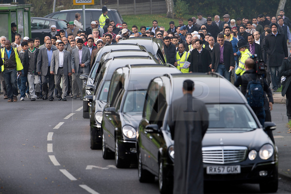 © London News Pictures. 24/10/2012. Harlow, UK. Members of the local Muslim community follow the funeral cortege from the Islamic Centre following the Funeral service of Dr Sabah Usmani and her five children Hira (12), Sohaib (11) Muneeb (9), Rayyan (6) and Maheen (3) at Harlow Islamic Centre in Harlow, Essex, UK on October 24, 2012. Dr Sabah Usmani and her five children died blaze at their home in Harlow last week. Photo credit: Ben Cawthra/LNP