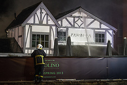 © Licensed to London News Pictures . 13/03/2013 . Alderley Edge , Cheshire , UK . Famous celebrity nightclub , Panacea , in Alderley Edge , is ablaze tonight (12th March) . Fire crews and police were initially called to the venue at 22:30 on Tuesday night (12th March) . Around 50 fire-fighters from Cheshire and Greater Manchester worked to control the fire at the venue , which is adjacent to a petrol station and residential properties in the affluent village of Alderley Edge . This is the second time in five years the venue has been destroyed by fire , previously following a £3.2 million refurbishment in September 2008 . Photo credit : Joel Goodman/LNP
