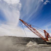 A drag line kicks up cloud of dust as it digs a coal pit at the Navajo Mine near Farmington Wednesday.