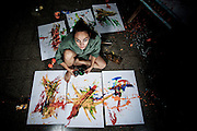 A young female artist painter works in her studio