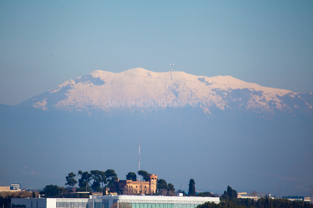 View of the mountain of Montseny, Barcelona, with snow, February 2018. In the foreground is the Castell de Sant Marcal in Cerdanyola del Valles. Photograph made in Sant Cugat del Valles.