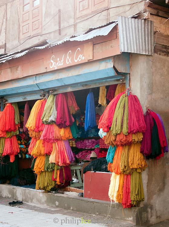 Shop selling colourful fabrics in Srinigar, Kashmir, India