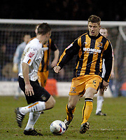 Photo: Leigh Quinnell.<br /> Luton Town v Hull City. Coca Cola Championship. 13/03/2007. Hulls Danny Coles looks to win the ball from Lutons Sol Davis
