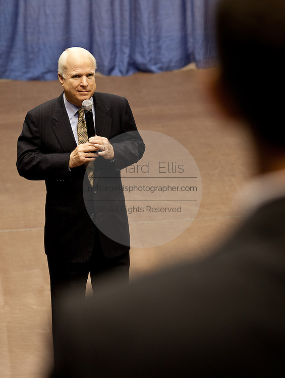 Sen. John McCain (R-AZ) listens to a question from the audience during a health care town hall meeting with fellow Republican Sen. Lindsay Graham September 14, 2009 at the Citadel in Charleston, SC.