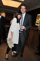 CLAUDIA WINKLEMAN and KRIS THYKIER at the Lighthouse Gala Auction in aid of The Terrence Higgins Trust held at Christie's, 8 King Street, St.James' London on 19th March 2012.