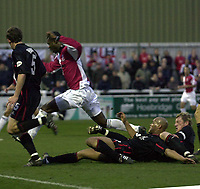 Picture: Raymond Field<br /><br /><br />Woking F.C v Kidderminster Harriers FA second round<br /><br />06/12/2003<br /><br />Craig Hinton Adie Smith and Danny Williams try to stop Raphael Nade