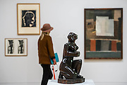 Anika Rice (behind Kneeling Figure) visits the show in preparation for a programme she will make - Barbara Hepworth: Sculpture for a Modern World opens at Tate Britain -  the first London museum retrospective or five decades of the work of Hepworth (1903-75), one of Britain's greatest artists. This major retrospective opens on 24 June 2015 and will emphasise Hepworth's prominence in the international art world. It highlights the different contexts and spaces in which Hepworth presented her work, from the studio to the landscape. Highlights include: A room dedicated to a series of sculptures Hepworth carved in the 1940s, which are characterised by the dramatic hollowing out of pieces of wood and the painting of the interior spaces she opened up. Works in this room include the famous Pelagos 1946 ('sea' in Greek), which was inspired by a view of the bay of St Ives, Cornwall; Imposing wooden sculptures made from huge logs of the sumptuous tropical hardwood guarea, such as Corinthos 1954-5 – a grand 1 metre x 1 metre sculpture named after the ancient Greek city in which Hepworth summed up the light and landscape of Greece. The unusually large size of guarea pieces allowed Hepworth to experiment with interior spaces through the use of string, spiralling edges, paint or rough carved surfaces to maximise the effect of light; An architectural installation inspired by the Rietveld Pavilion, originally built at the Kröller-Müller Museum, Otterlo in 1965 which housed a display of Hepworth bronzes at its opening. The structure in the exhibition explores how Hepworth presented her works and how she worked on an international stage. Barbara Hepworth: Sculpture for a Modern World is at Tate Britain from 24 June to 25 October 2015.