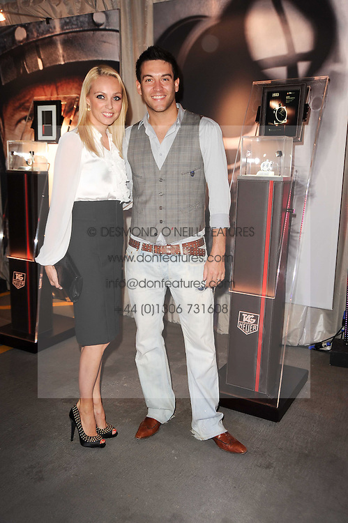 Camilla Dallerup and Kevin Sacre at a party to celebrate 150 years of TAG Heuer held at the car park at Selfridge's, London on 15th September 2010.