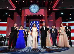 President Donald Trump and First Lady Melania Trump appear with family members and Vice President Mike Pence, his wife Karen Pence at the Liberty Ball at the Washington Convention Center on January 20, 2017 in Washington, D.C. Trump will attend a series of balls to cap hisInauguration day. Photo by Kevin Dietsch/UPI