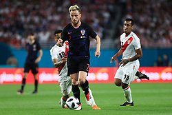 March 23, 2018 - Miami Gardens, Florida, USA - Croatia midfielder Ivan Rakitic (7) controls the ball past Peru defender Yoshimar Yotun (19) and Peru defender Renato Tapia (13) during a FIFA World Cup 2018 preparation match between the Peru National Soccer Team and the Croatia National Soccer Team at the Hard Rock Stadium in Miami Gardens, Florida. (Credit Image: © Mario Houben via ZUMA Wire)