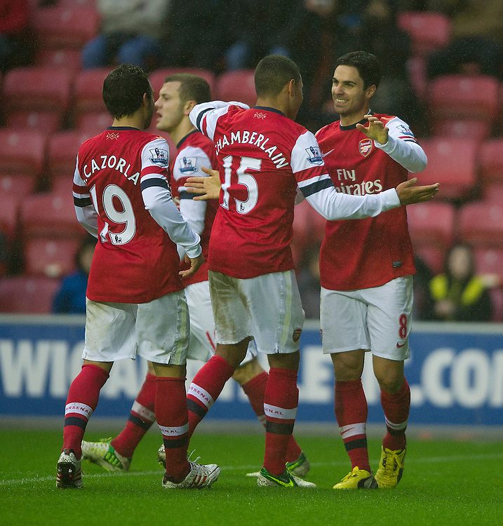 Arsenal's Mikel Arteta celebrates scoring the only goal of the match from the penalty spot with team-mate Alex Oxlade-Chamberlain  ..Football - Barclays Premiership - Wigan Athletic v Arsenal - Saturday 22nd December 2012 - DW Stadium - Wigan..