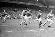 Wexford Defender Jimmy Prendergast, clears in front of his own goalmouth, with teammate Liam Bennett and Cork's Brendan Cummins, Charlie McCarthy following him during the All Ireland Senior Hurling Final, Cork v Wexford in Croke Park on the 5th September 1976. Cork 2-21, Wexford 4-11.