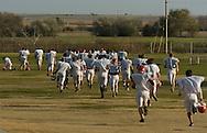 11/7/07 Smith Center, KS.The Smith Center High School football team runs to practice...(Chris Machian/Prairie Pixel Group)
