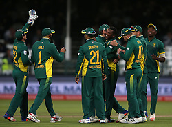 Andile Phehlukwayo of South Africa is congratulated for bowling George Bailey of Australia during the 5th ODI match between South Africa and Australia held at Newlands Stadium in Cape Town, South Africa on the 12th October  2016<br /> <br /> Photo by: Shaun Roy/ RealTime Images