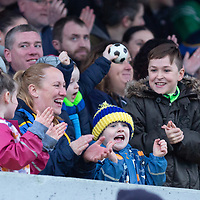 Clare supporters shout on the team