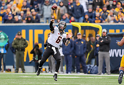 Nov 23, 2019; Morgantown, WV, USA; Oklahoma State Cowboys quarterback Dru Brown (6) throws a pass during the second quarter against the West Virginia Mountaineers at Mountaineer Field at Milan Puskar Stadium. Mandatory Credit: Ben Queen-USA TODAY Sports