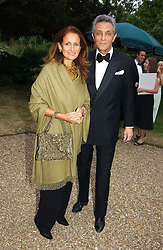 ISOBEL GOLDSMITH and ANDREW KERMAN at a fund raising event for The Galapagos Conservation Trust entitled 'Some Enchanted Evening' at the Chelsea Physic Garden Chelsea, London on 17th June 2004.
