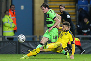 Forest Green Rovers Theo Archibald(18) is tackled by Oxford United's Marcus Browne(10) during the The FA Cup 1st round match between Oxford United and Forest Green Rovers at the Kassam Stadium, Oxford, England on 10 November 2018.