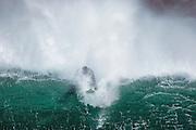 Surfer breaking through thr wave | Sorfer som bryter gjennom bølgen.