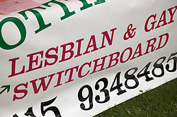 Banner displaying contact number for Lesbian and Gay people at the Nottingham Pride Gay Lesbian festival; held at the Arboretum,