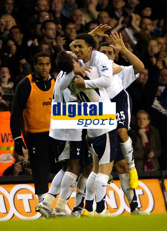 Photo: Ed Godden.<br /> Tottenham Hotspur v Chelsea. The Barclays Premiership. 05/11/2006. Robbie Keane (L) lifts up Goal scorer Aaron Lennon after scoring to make it 2-1.