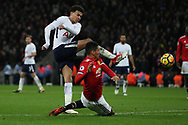 Delle Alli of Tottenham Hotspur (L) takes a shot at goal. Premier league match, Tottenham Hotspur v Manchester Utd at Wembley Stadium in London on Wednesday 31st January 2018.<br /> pic by Steffan Bowen, Andrew Orchard sports photography.