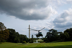 President Donald Trump arrives on the South Lawn aboard Marine One with First Lady Melania Trump and his son Barron, after returning to the White House on Aug. 19, 2018 in Washington, D.C. President Trump was returning from the weekend at his Bedminster, New Jersey golf resort. Photo by Pete Marovich/AbacaPress/Pool