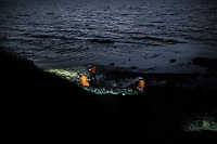 LESVOS, GREECE - FEBRUARY 09: Spanish volunteers from Proem-Aid search for stranded refugees that arrived on a beach on the south of Lesvos on a wooden boat during the night on February 09, 2015 in Lesvos, Greece. Photo: © Omar Havana. All Rights Are Reserved